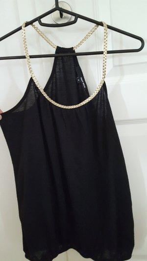 schwarzes Top mit Golddetails