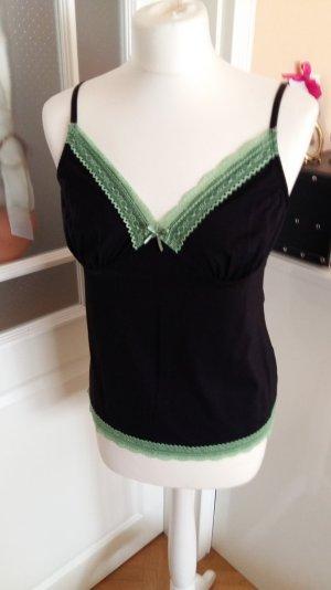 schwarzes Top mit grüner Spitze
