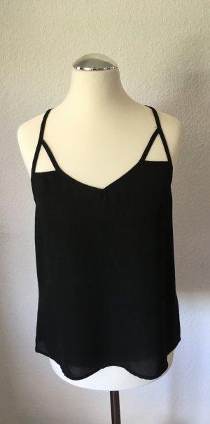 Schwarzes Top mit raffiniertem Rückendetail