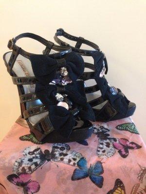 Sehr hohe Sandaletten mit Schleifen von Buffalo (letzter Preis)