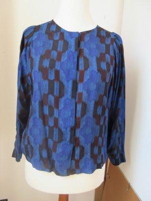 Sehr schöne blaue Bluse mit grafischem Muster