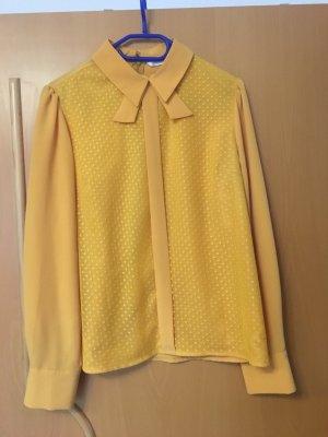 Cols de blouses orange doré