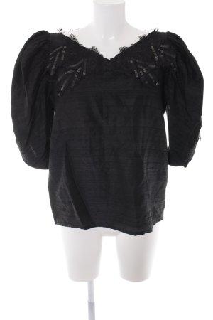 Blusa in seta nero elegante
