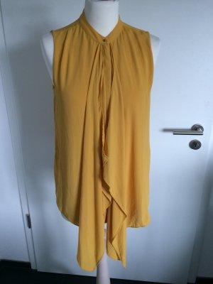 Senfgelbe Bluse mit verdeckter Knopfleiste