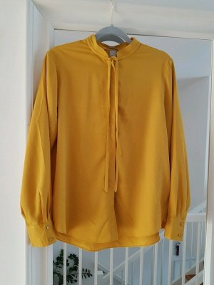 H&M Blusa de cuello alto amarillo oscuro-amarillo
