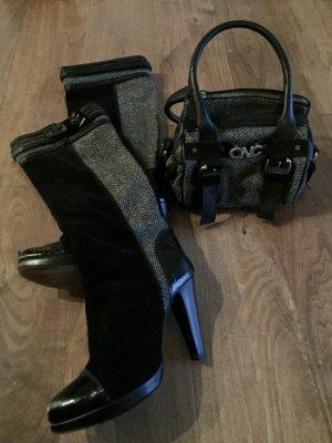 Set CNC aus Stiefeln und Tasche