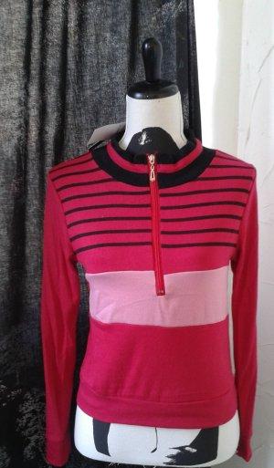 Camiseta tipo polo rosa
