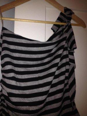 Camisa de un solo hombro negro-blanco