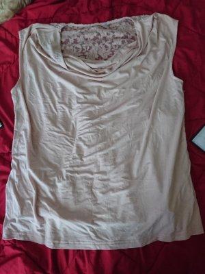 Camisa con cuello caído color rosa dorado