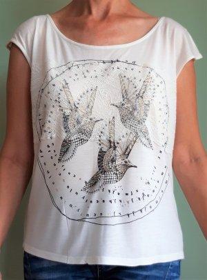 Shirt von Vero Moda: zauberhafter Print in Schwarz/Gold mit Spitzenapplikation