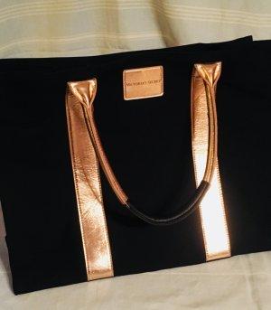 Shopper in schwarzem Stoff mit goldenen Applikationen