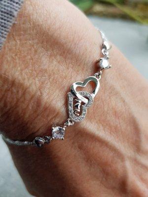 Silberarmband mit 2 Herzen