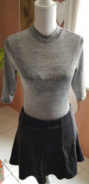 Top à col roulé argenté-gris clair