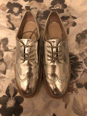 Silberne Plateau Schuhe