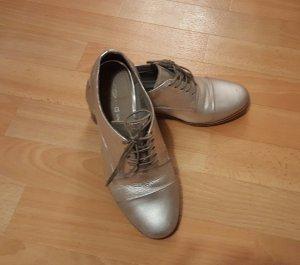 silberne Schuhe von Cox