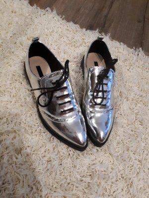 silberne Schuhe von Lost Ink