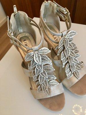 Silberne verspielte High heels