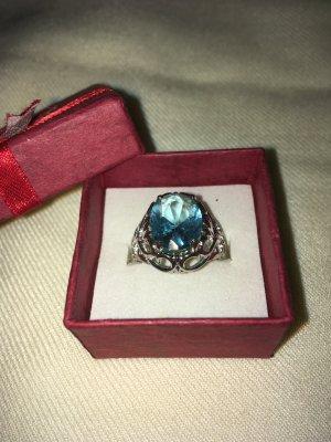 Silberring mit hellblauem Stein