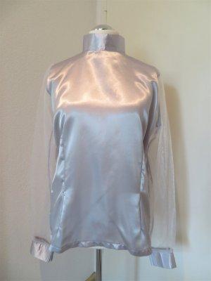 Blusa brillante color plata Poliéster