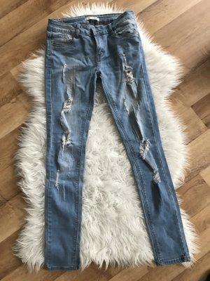 Skinny Destroyed Jeans