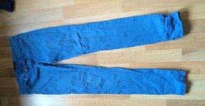 Skinny Jeans mit ausgewaschenem Sternen Motiv