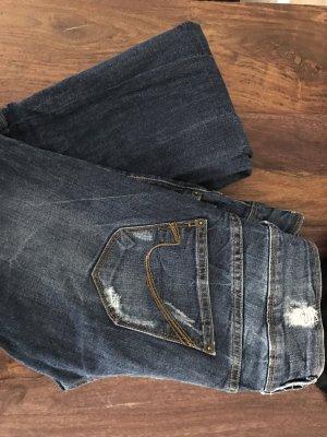 Skinny Jeans mit Löchern