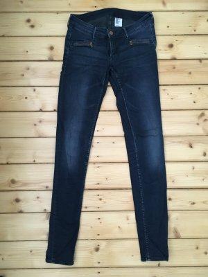 Skinny Jeans mit Reißverschluss-Taschen