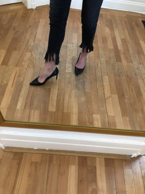 Slim Jeans mit Fransen