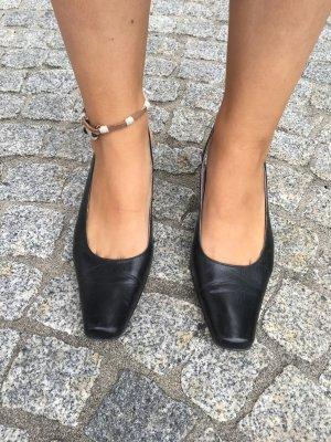Slingback pumps zwart