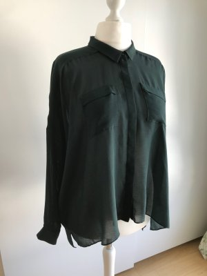 Smaragdgrüne transparente Maxibluse