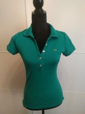 Smaragdgrünes Polo von Lacoste