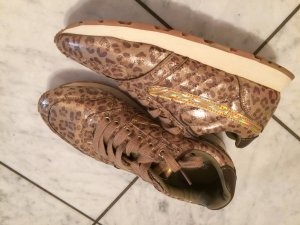 Sneackers in gold/Panther Optik