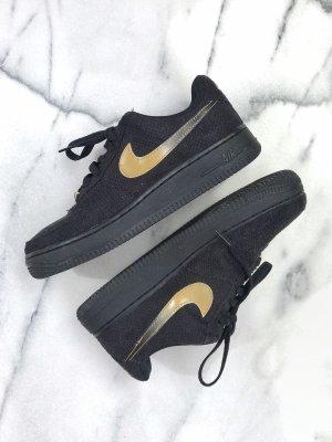 Nike Basket à lacet noir-doré