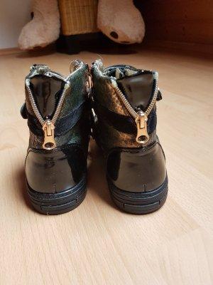 Sneakers in schwarz/gold