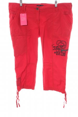 Soccx Pantalón pirata rojo-negro estampado temático look casual
