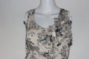 Sommerliches Kleid mit dezenter Rüschenblume am Dekollete
