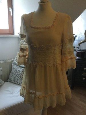 Blusa in merletto giallo pallido