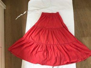 Jupe à plis rouge clair