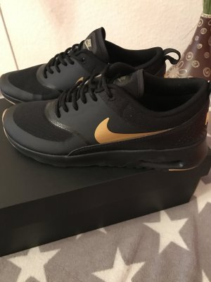Nike Sneaker nero-oro