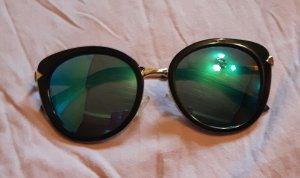 Gafas de sol redondas negro-color oro