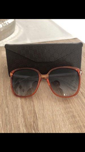 Gucci Ovale zonnebril bruin-oranje