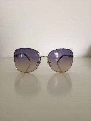 Sonnenbrille in blau mit Verlauf