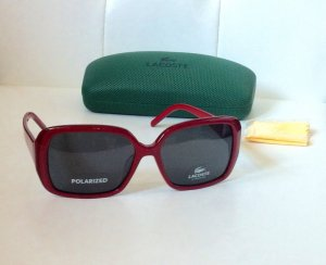 Sonnenbrille in Rot Lacoste mit Etui