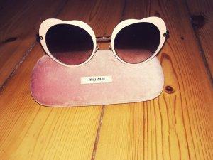 Miu Miu Gafas color rosa dorado metal