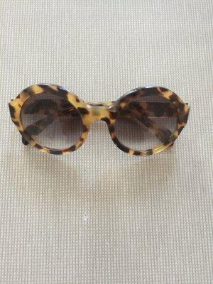 Sonnenbrille Prada rund leo Optik