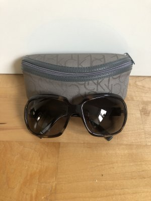 Calvin Klein Oval Sunglasses black brown