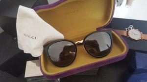 Gucci Zonnebril zwart-goud