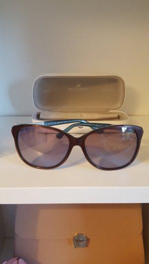 Swarovski Hoekige zonnebril bordeaux-korenblauw