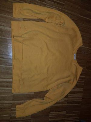 sonnengelber Pullover