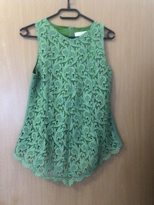 Blusa in merletto verde